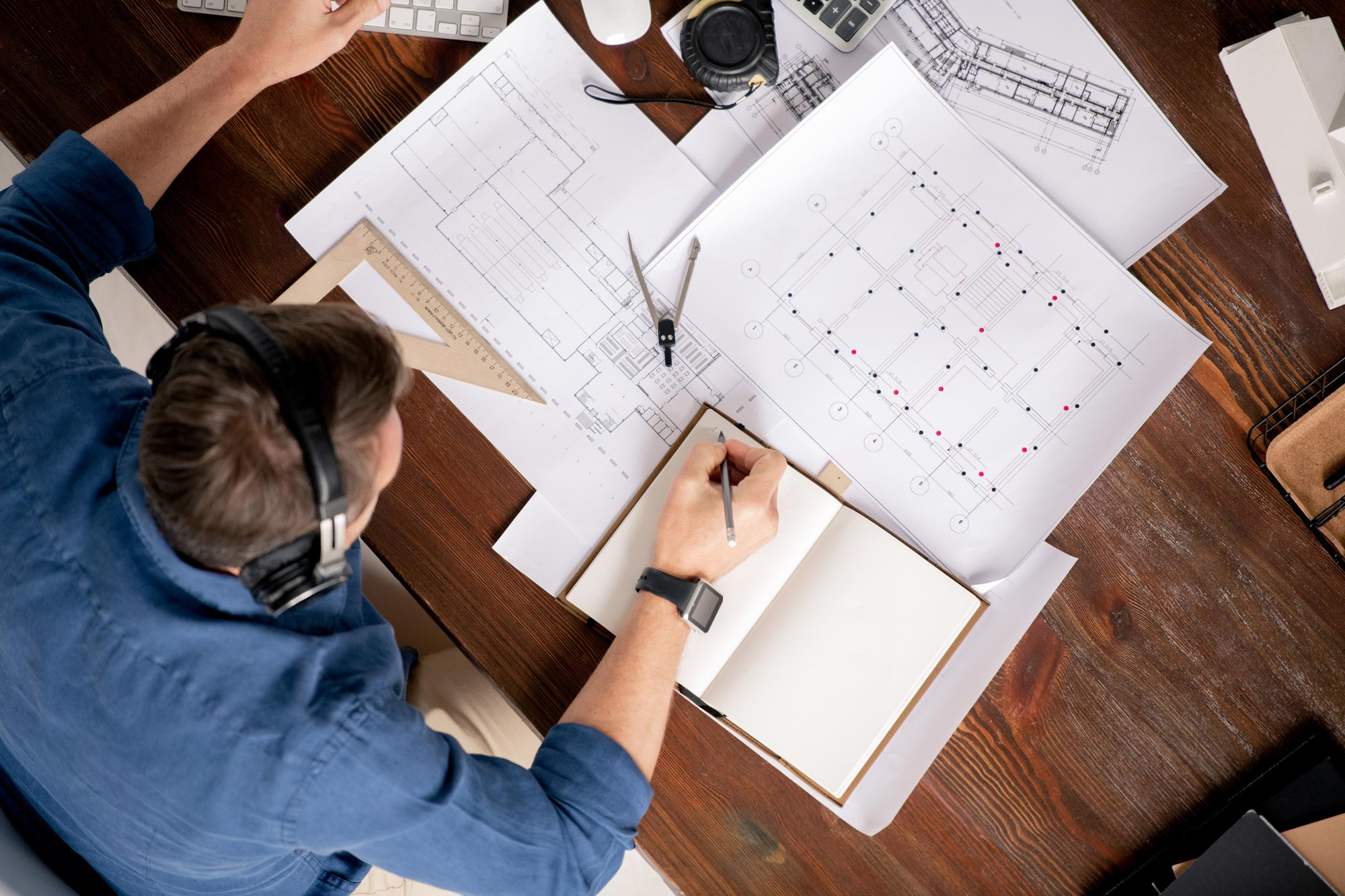 top-view-of-professional-engineer-with-notebook-an-TSNM6PF