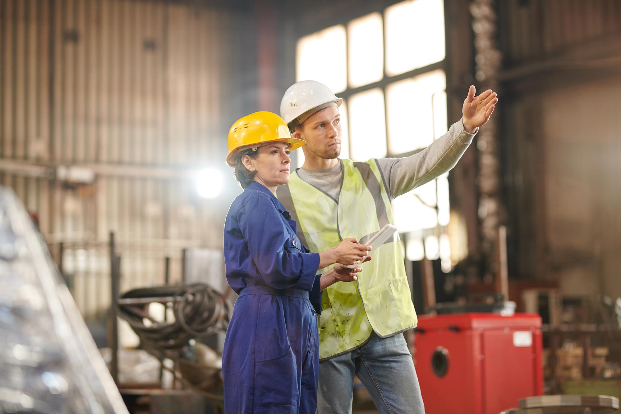 two-workers-inspecting-factory-EDA6L2N