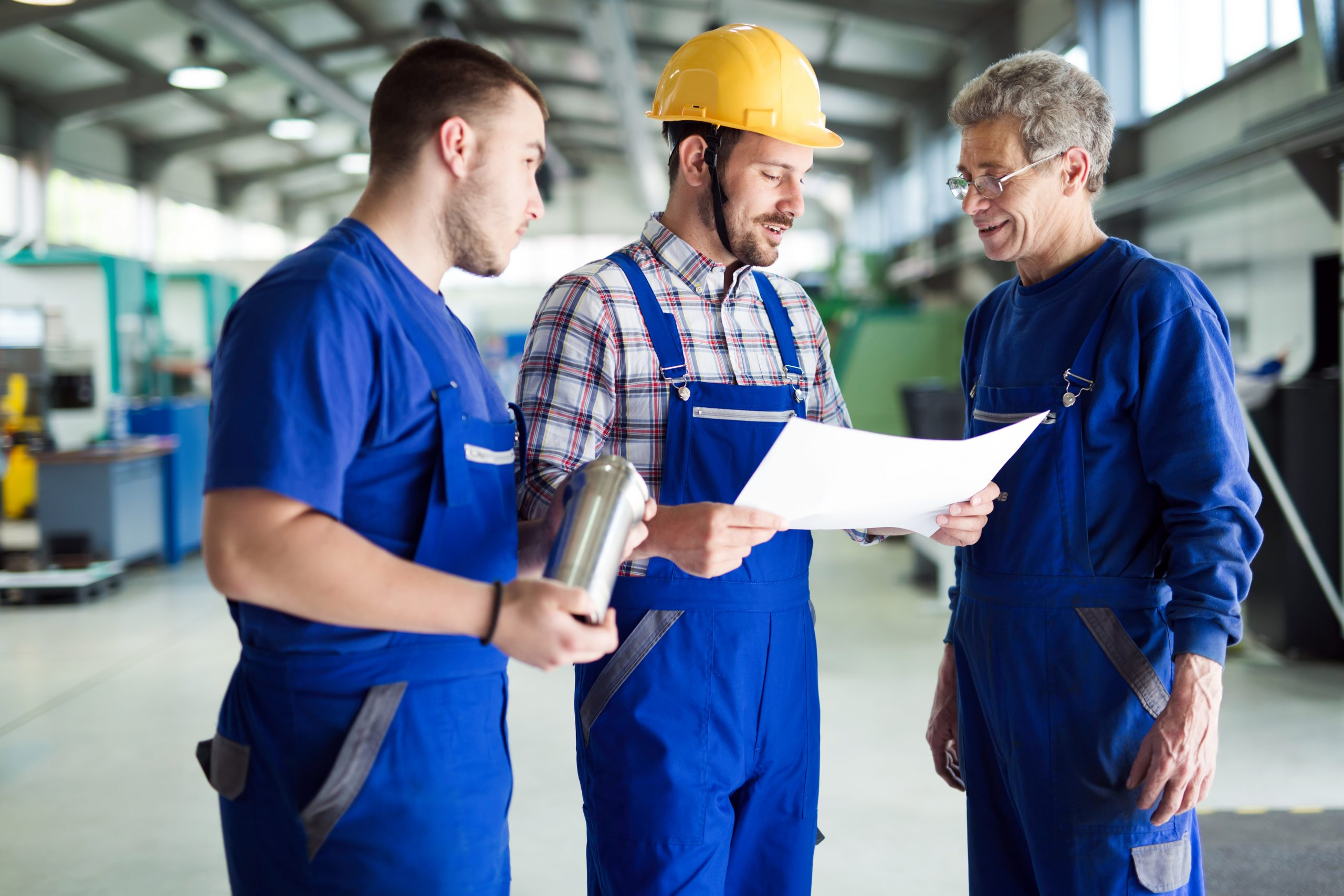 team-of-engineers-having-discussion-in-factory-GG8A8BU-scaled.jpg