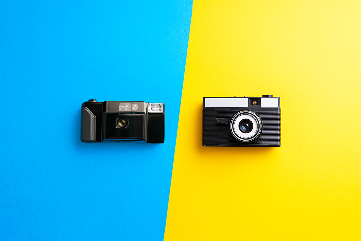 Multiple vintage cameras over colorful background
