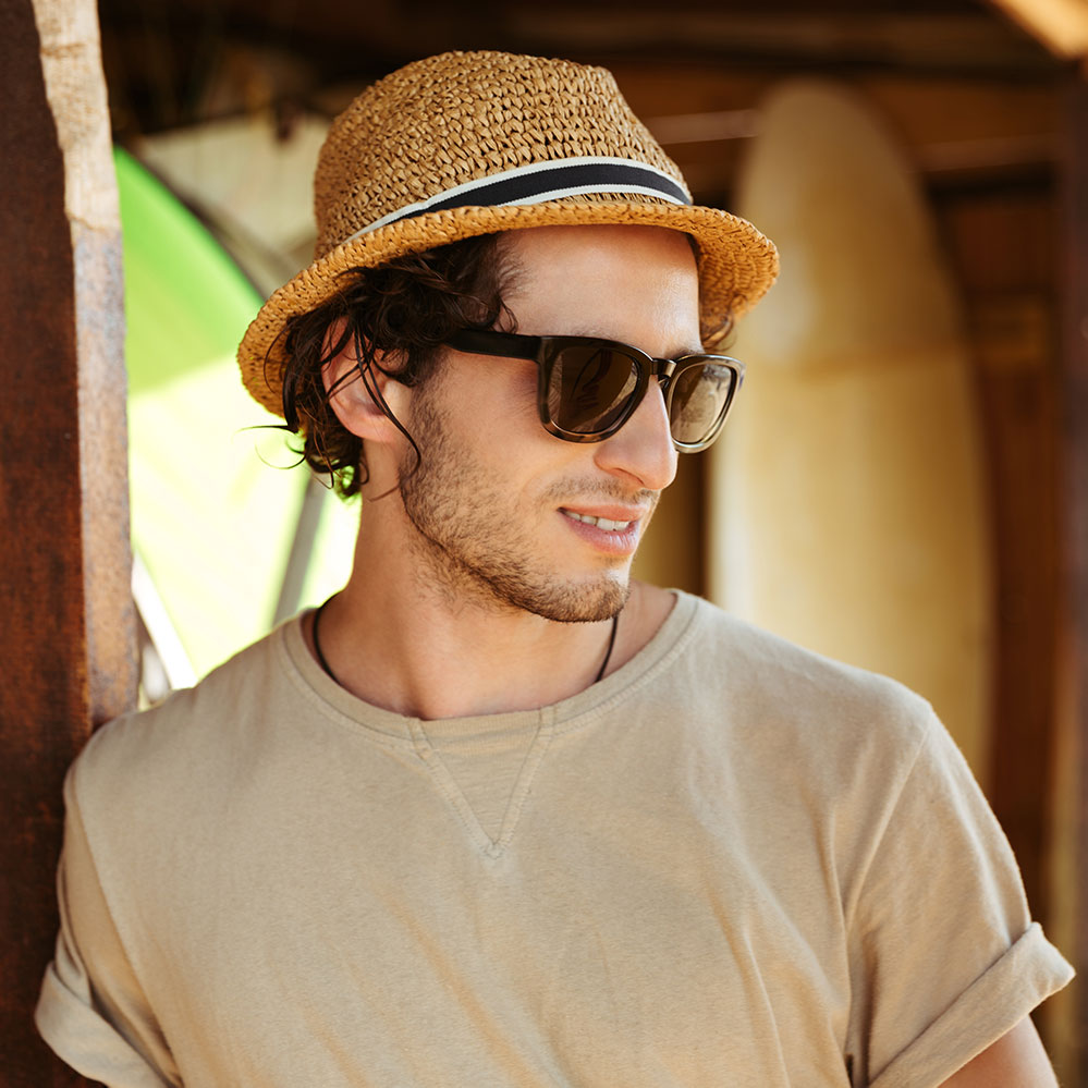 close-up-portrait-of-a-man-in-sunglasses-and-hat-PQHGFYQ