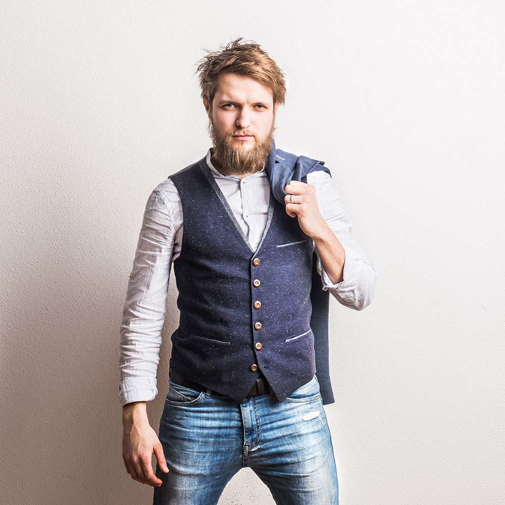 portrait-of-a-young-hipster-man-in-a-studio-copy-s-DYPKCQS