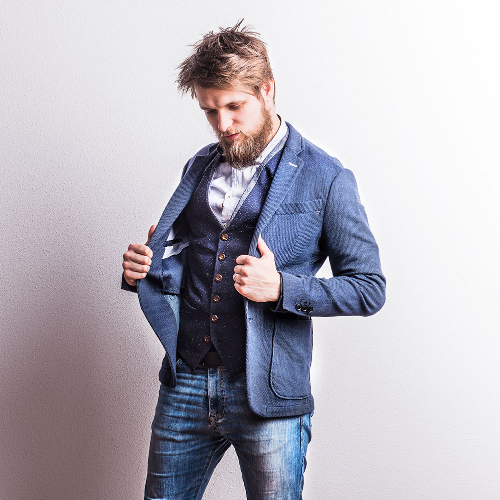 portrait-of-a-young-hipster-man-in-a-studio-copy-s-PXCSY2B