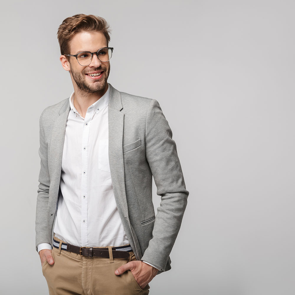 portrait-of-happy-young-businessman-posing-at-came-3MRXVKU