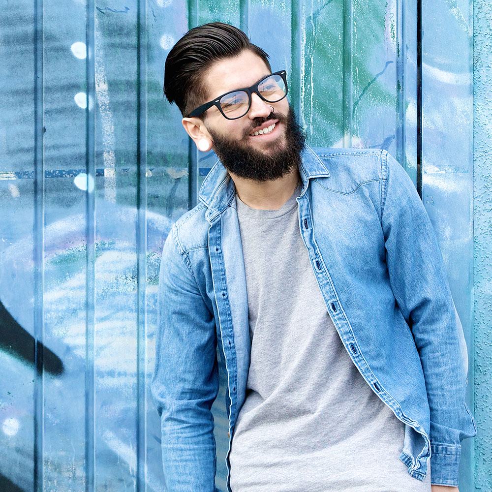 smiling-man-with-beard-and-glasses-PHWGANP