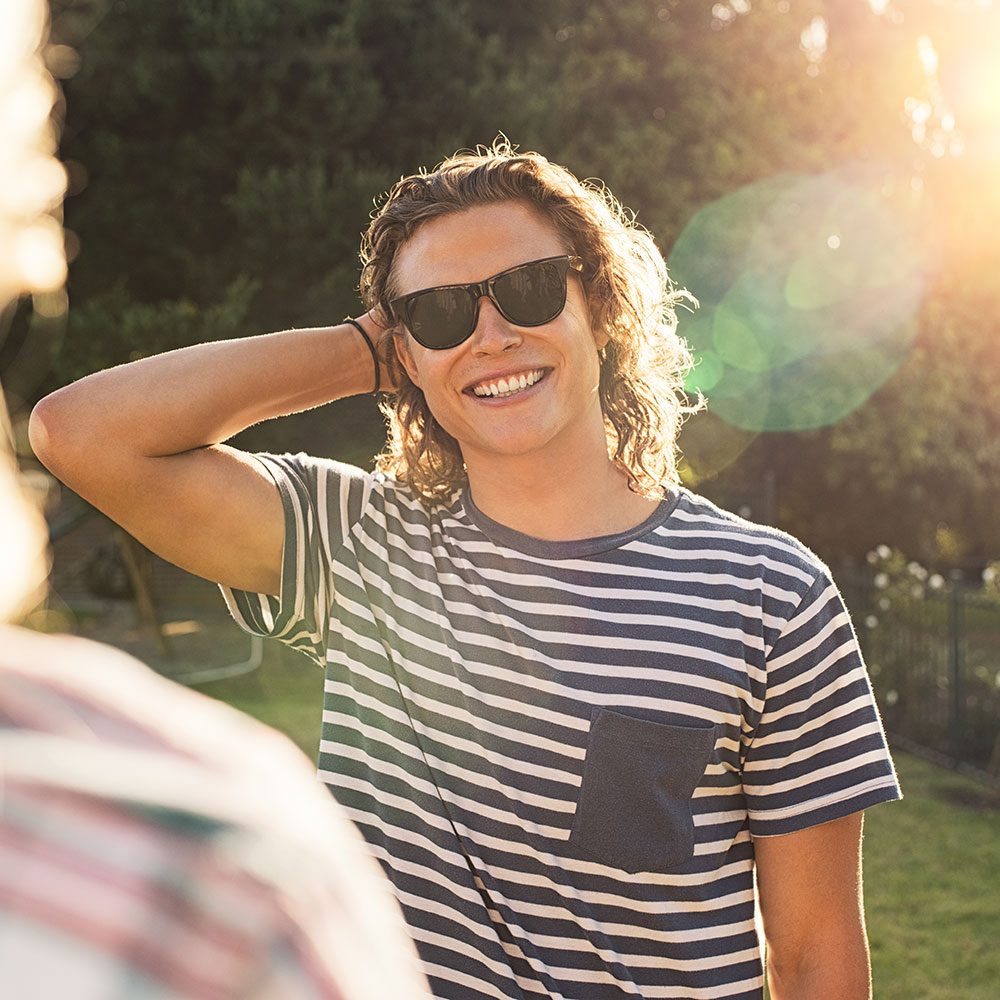 young-man-with-sunglasses-at-park-784T3HL